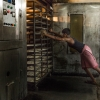A worker pushes the tray cart into the oven. Photographer: Arnav Rastogi/ Fseven Photographers